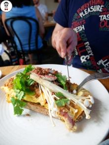 Smoked eel omelette, XO sauce, enoki mushroom, herb salad and caper crumb