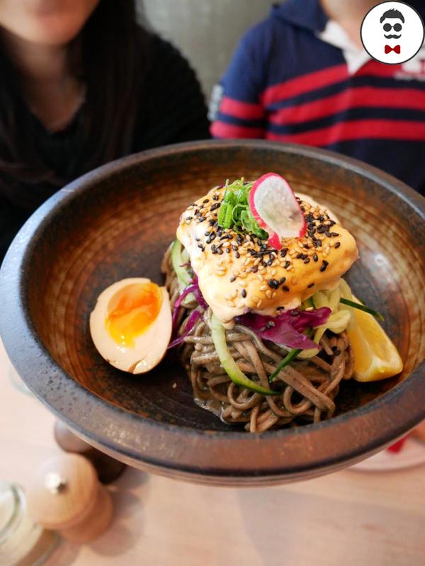 Salmon & Soba bowl with buckwheat noodles, black sesame paste, slow cooked salmon, soy egg, radish,cocktail sauce