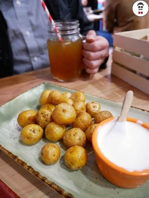 mini yellow potato served with sour cream