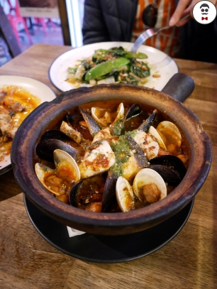 Moroccan claypot - couscous, seafood baked in eggplant sauce
