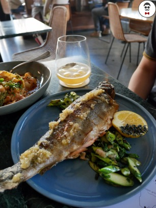 Whole market fish cooked with confit shallots and fried seymour greens